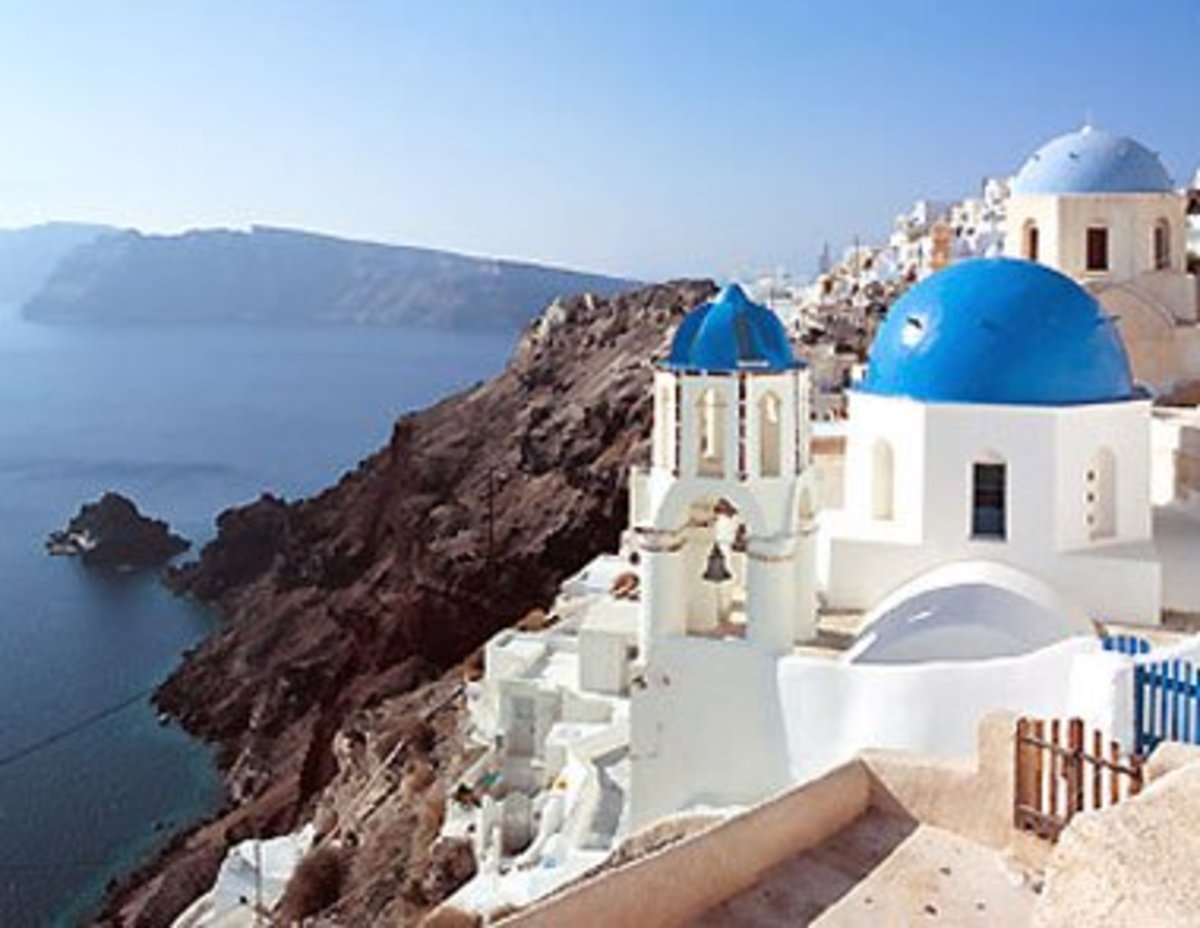 Blue skies, blue roofs and white buildings in Santorini