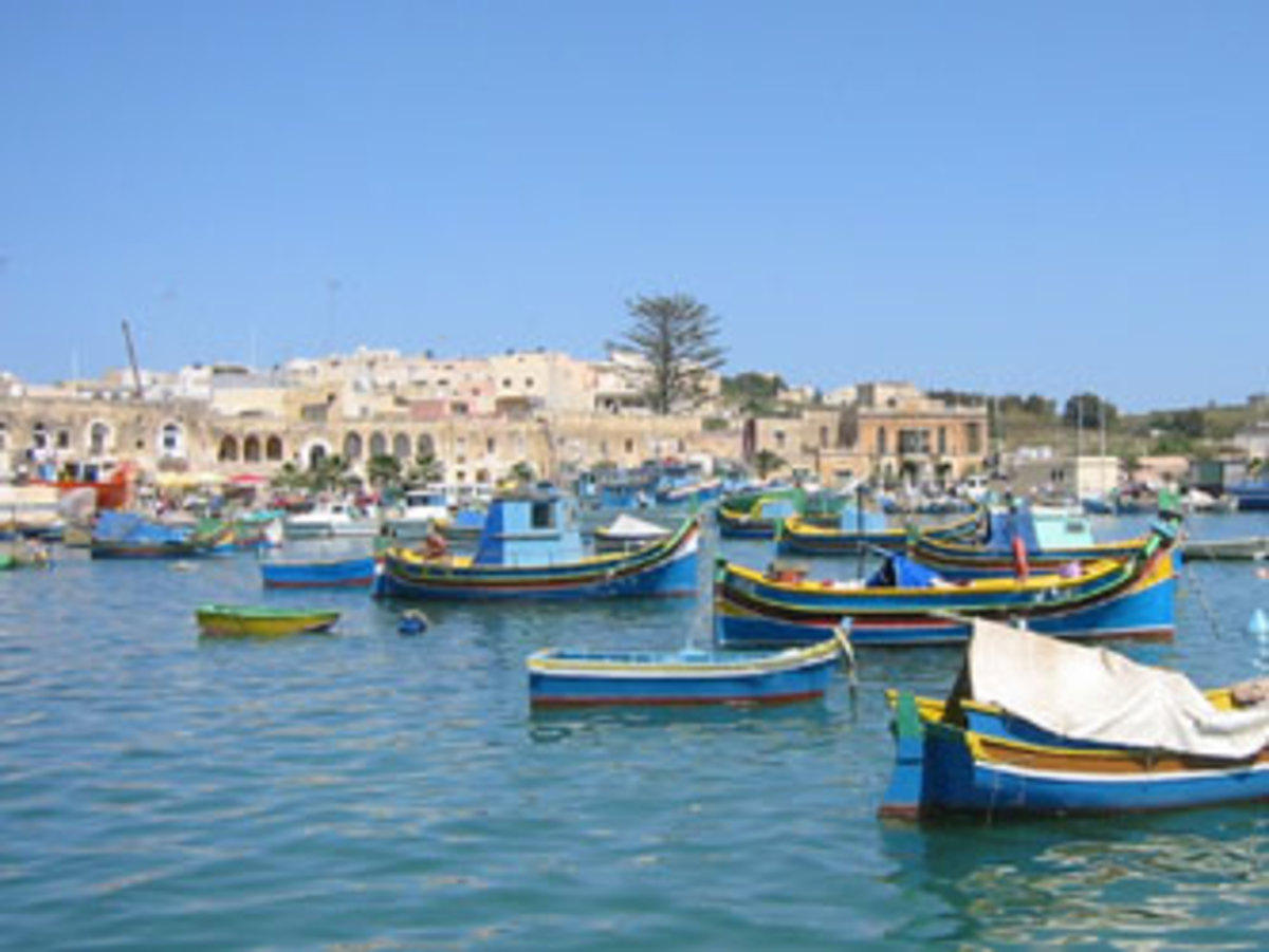 Maltese boats sit calmly in the harbor