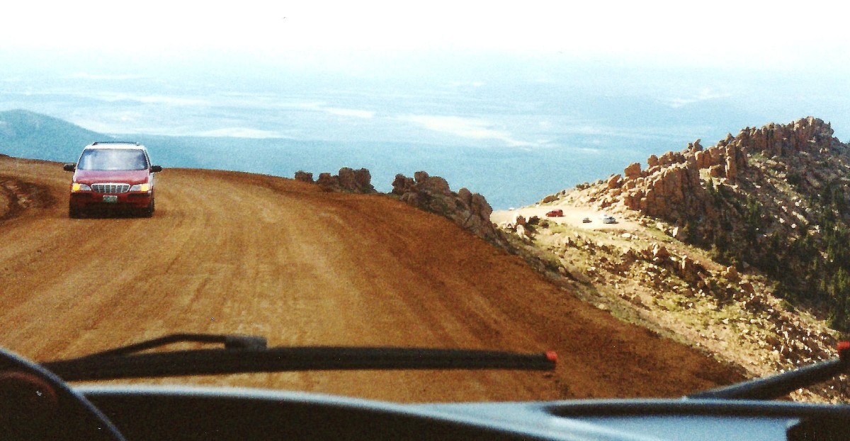 Looking at a car venturing up Pikes Peak.