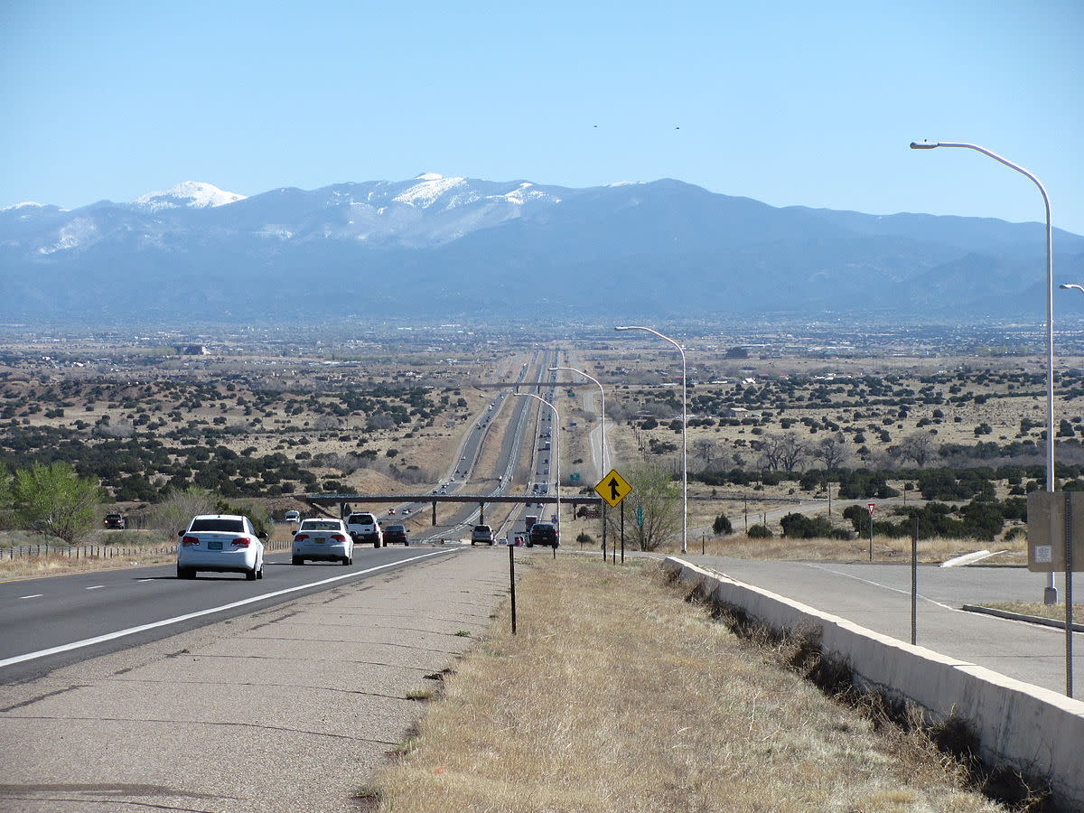 Interstate 25 approaching Santa Fe with Sangre de Christo Mountains in background.