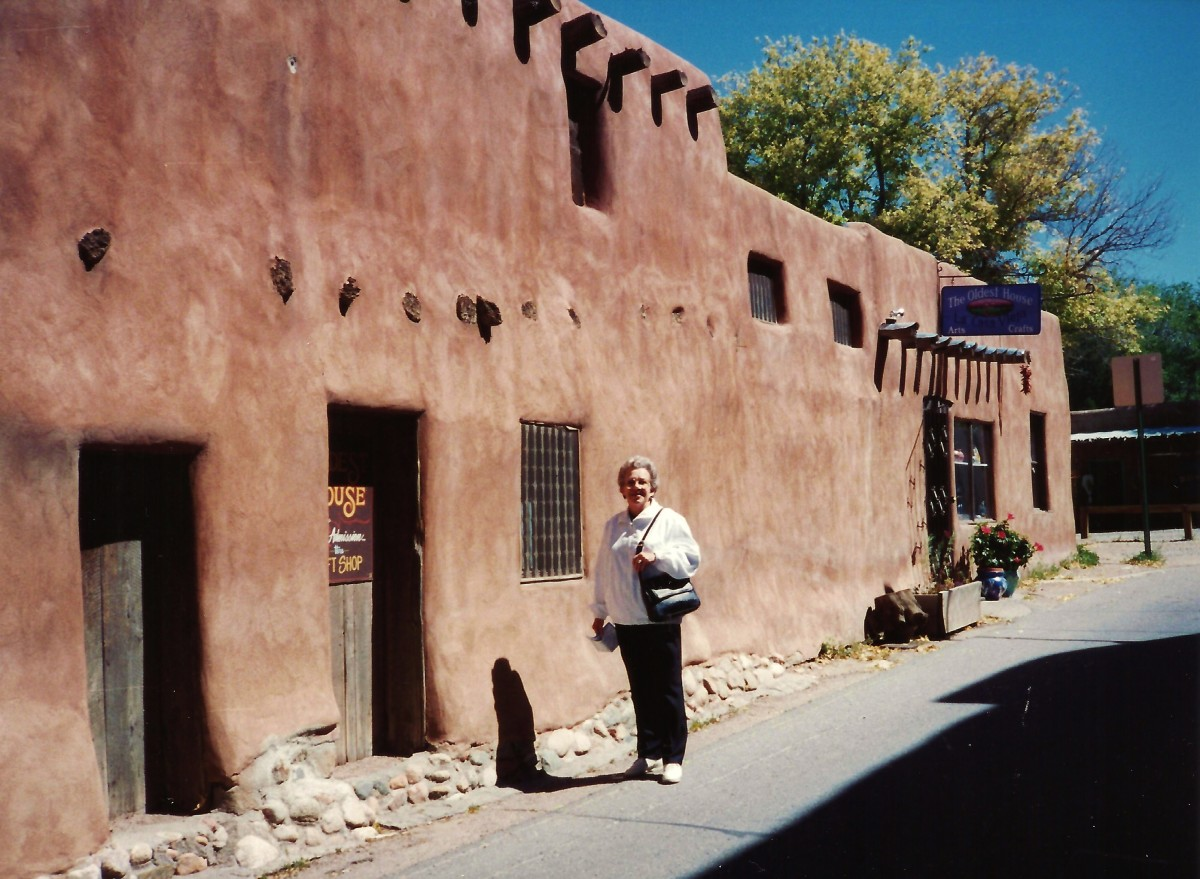My mother standing outside of the oldest house in the U.S.A.