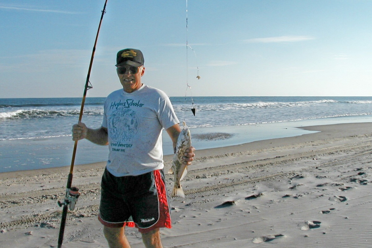 Hubby showing off his catch near Oregon Inlet.