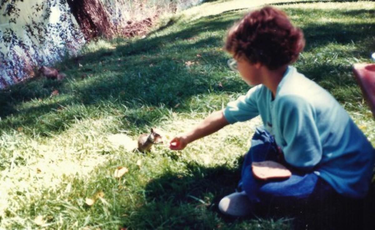 My niece feeding squirrels in Riverside Park