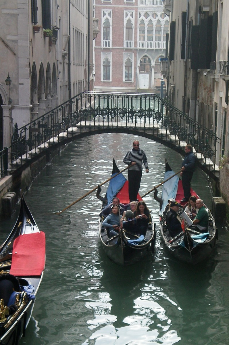Bridges are just high enough for a gondolier to pass (c) A. Harrison
