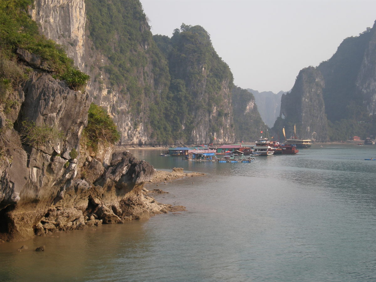 Floating Fishing Station at the Side of Some Cliffs; Halong Bay, Vietnam.