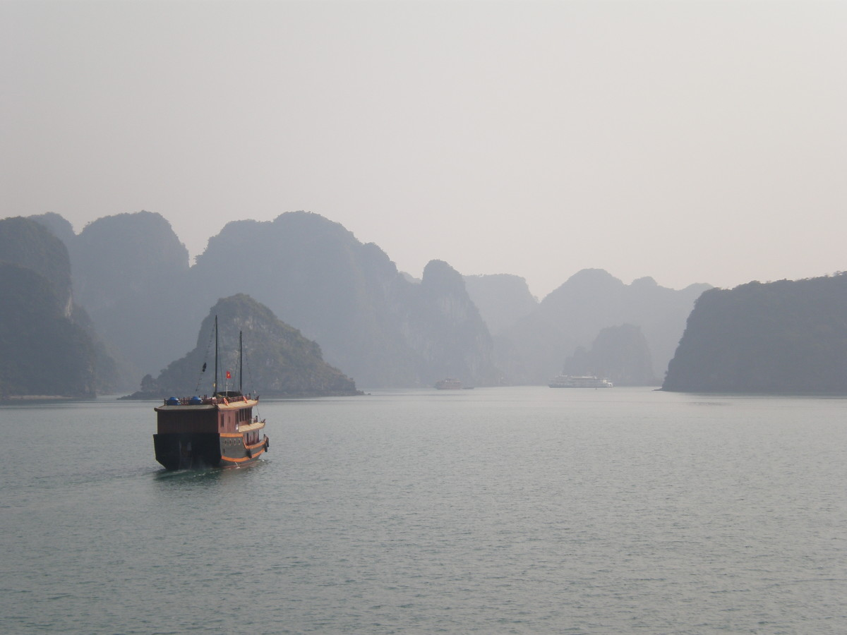 Boat sailing off into Halong Bay, Vietnam.