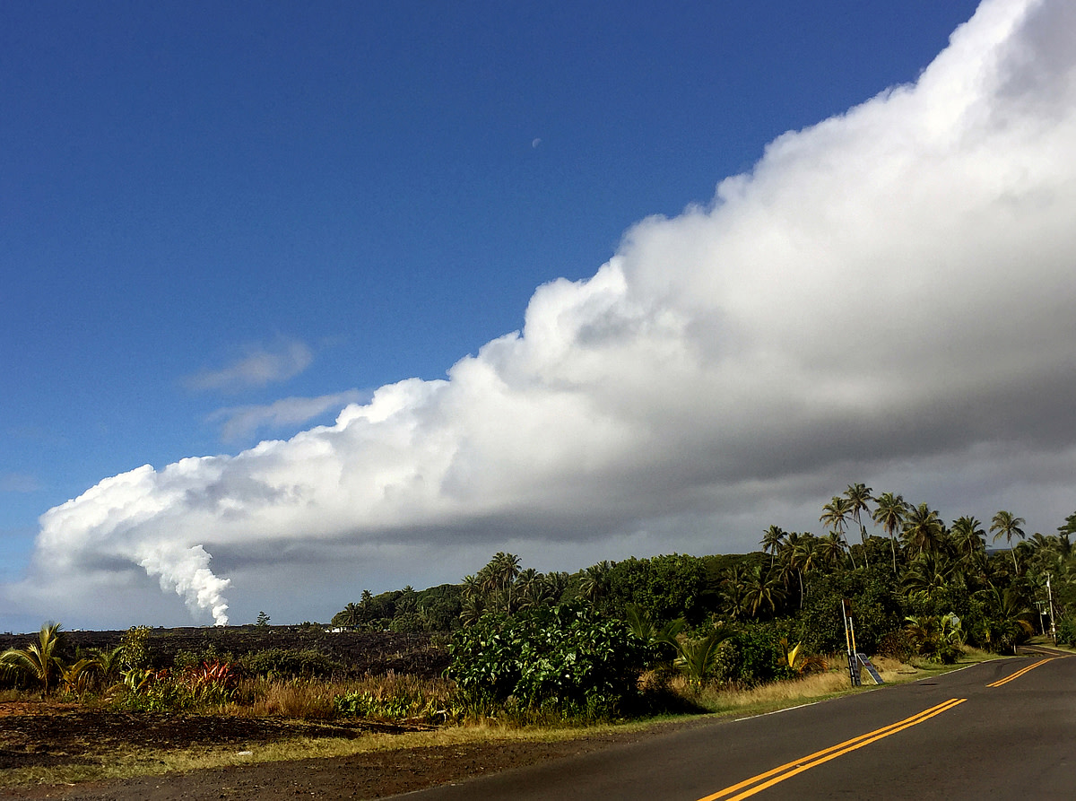 View from Red Road toward Kalapana where the lava flows into the ocean.