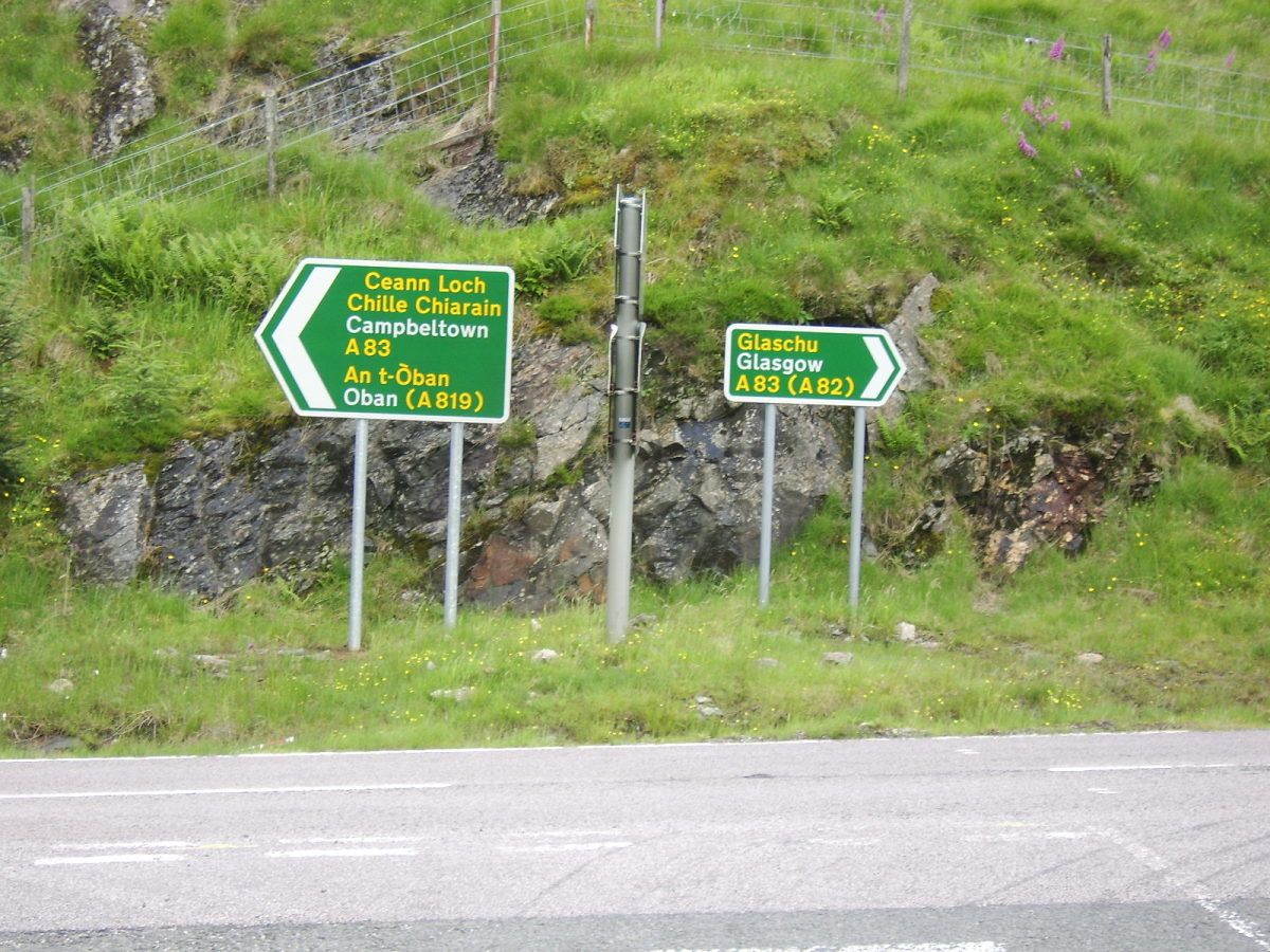 Road signs on the A83 at the Rest and Be Thankful, in both English and Gaelic