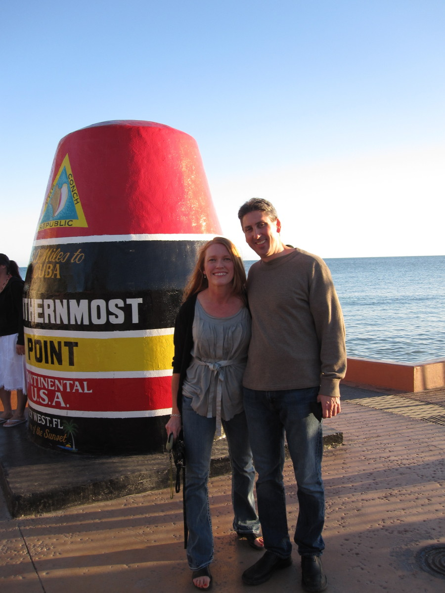 The author and her husband at Southernmost Point in February 2011
