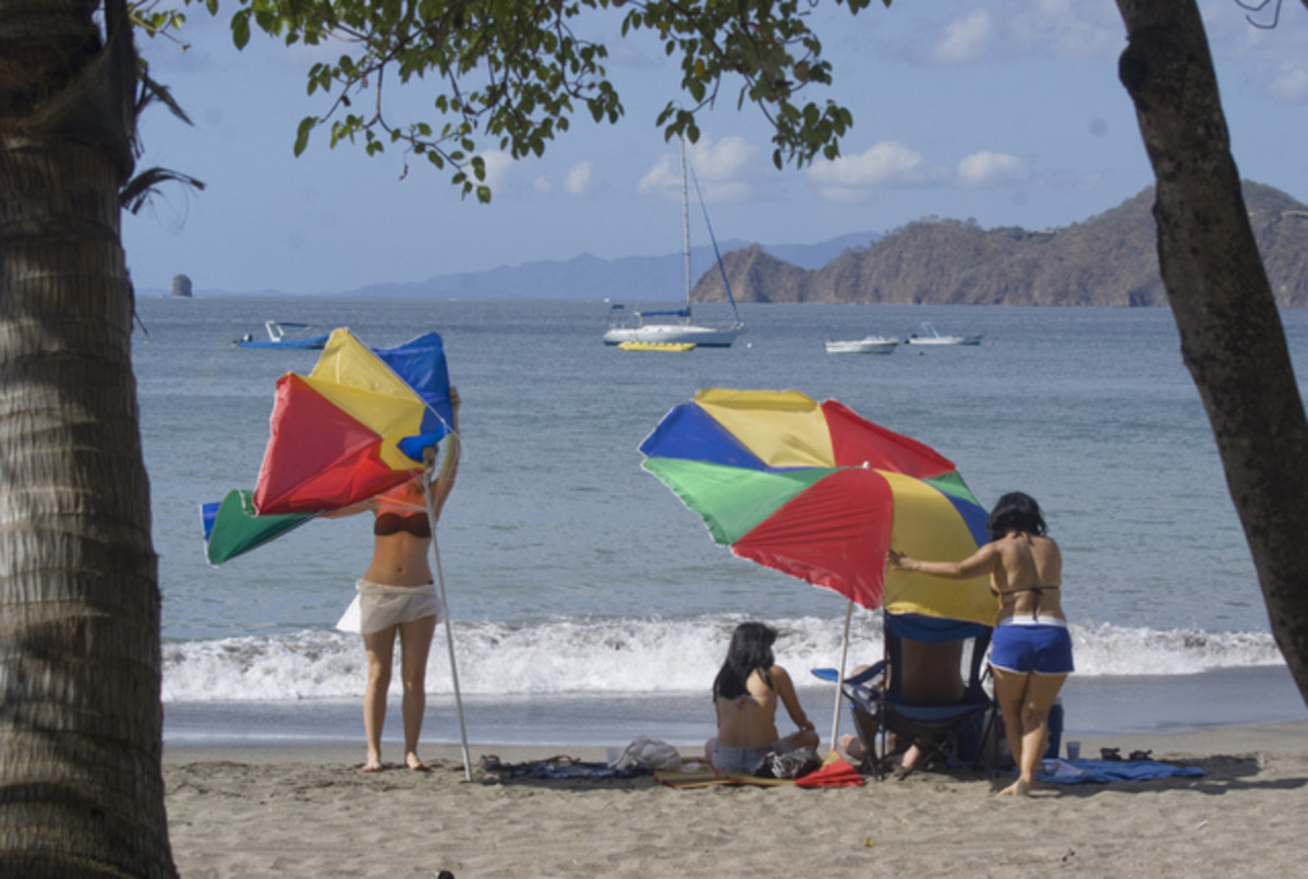 The winds in January cause umbrella problems on the beach.  It is best to find natural shade.  This photo was taken on Playa Hermosa in Guanacaste on January 10, 2012.