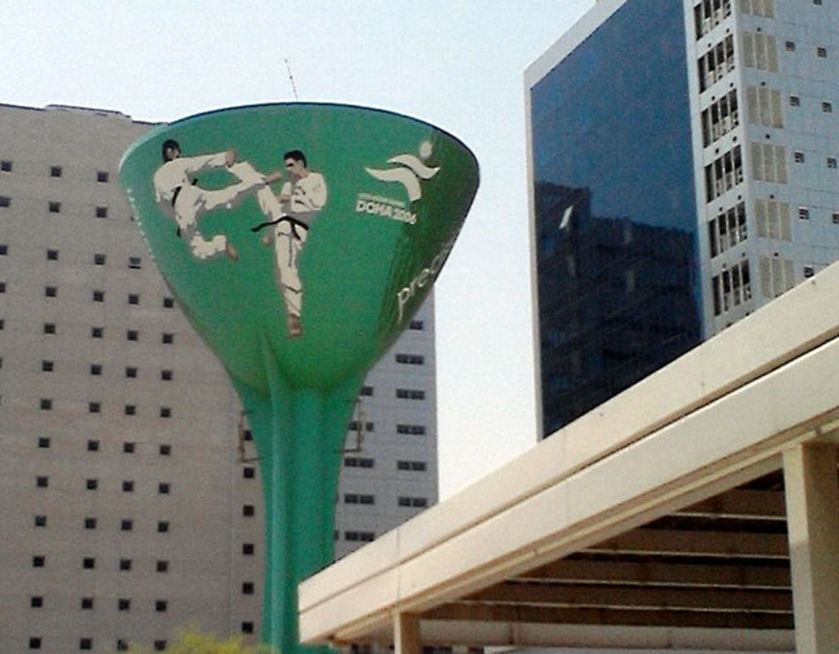 Water tower with karate kids - in the run-up to the doha asia games, 2006, the many water towers around town were painted with sporting themes to promote the games.