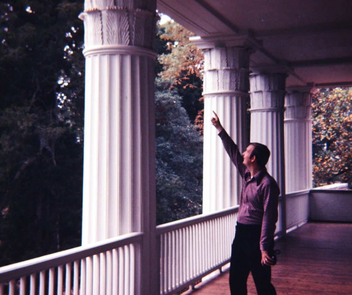 Pointing at the details at the top of the columns.