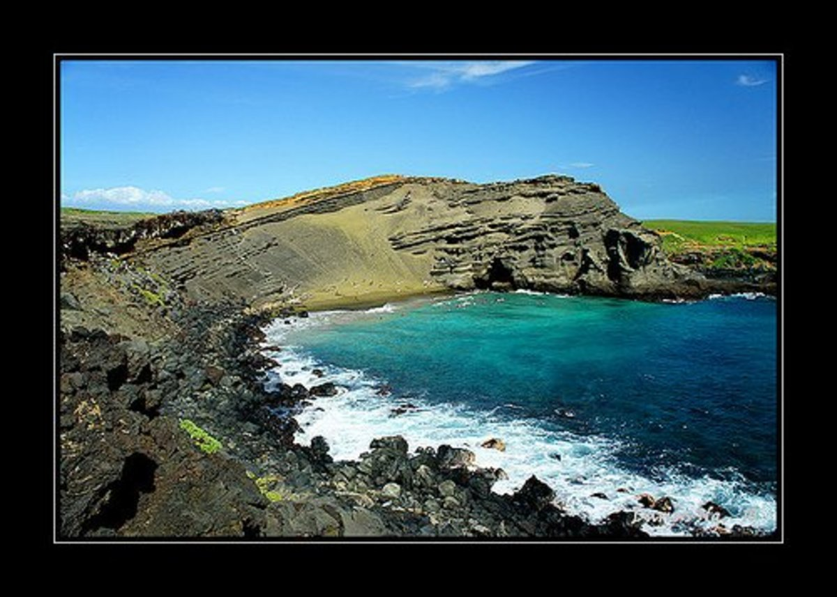 Green Sand Beach has the most beautiful rock formations in the world.  The green color comes from olivine, a mineral found by volcanoes.