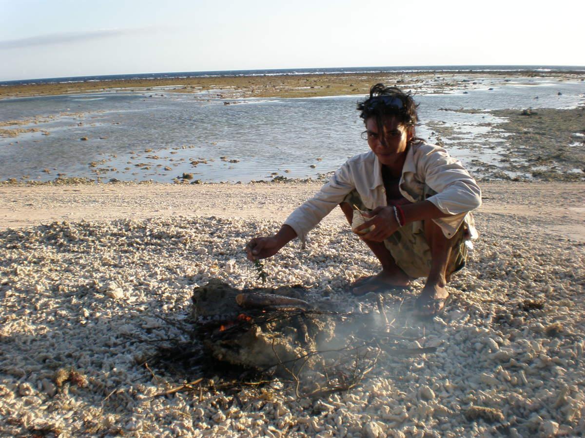 """Banana grilling fish """"all natural"""" during sunset at the beach. Gili Trawangan, Gili Islands, Indonesia."""