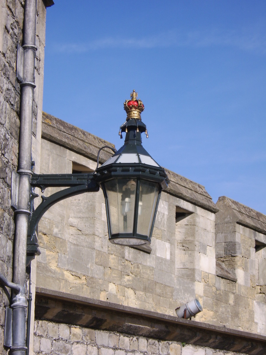 The external lamp fittings serve as a permanent reminder of who calls Windsor Castle home...