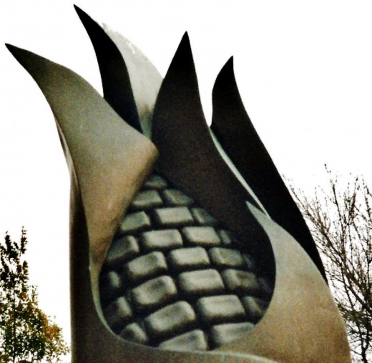 Closeup photo of the corn topped sculpture by Iowa artist Tom Stancliffe.