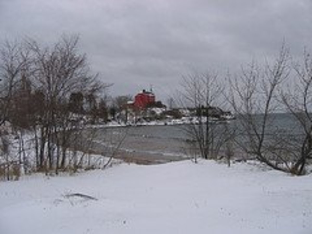 A winter view of the Lake Superior shore looking toward the U. S. Coast Guard Marquette Harbor Lighthouse, preserved by the Marquette Maritime Museum
