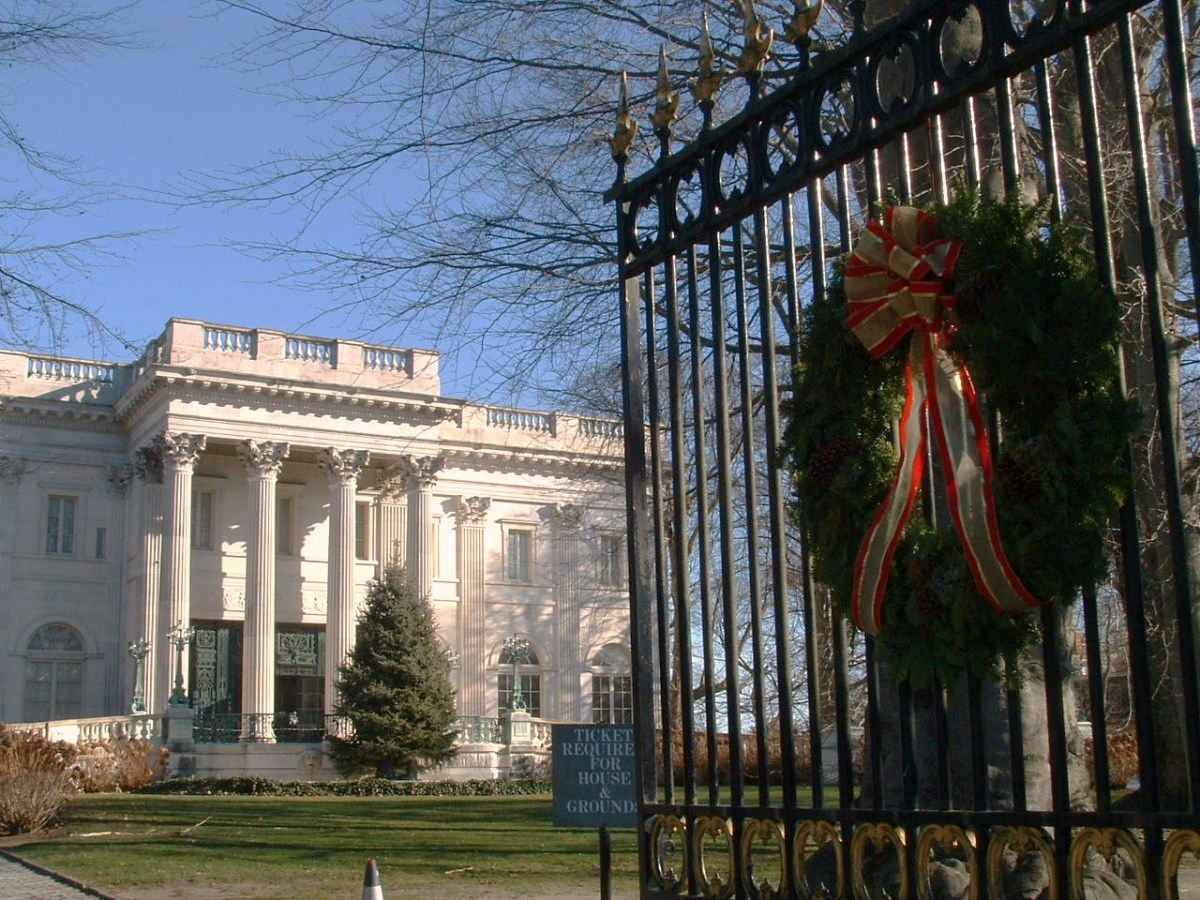 Front entrance gate of The Marble House decorated with a giant Christmas wreath.