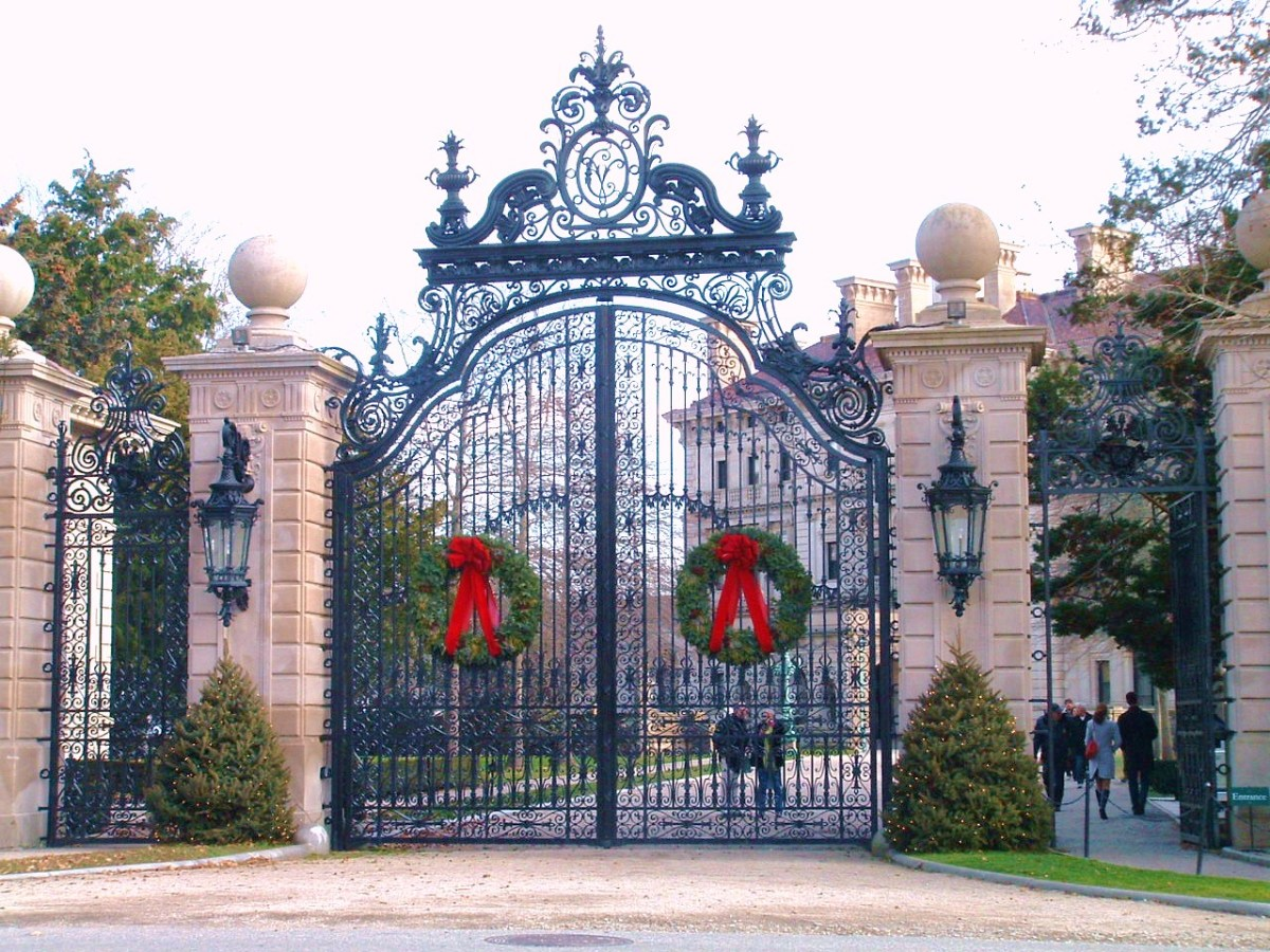 Breakers' main entrance has a 30 foot wrought iron gateway topped with elaborate scroll-work including the acorn and oak leaf family symbol, surrounding the initials of Cornelius Vanderbilt II.