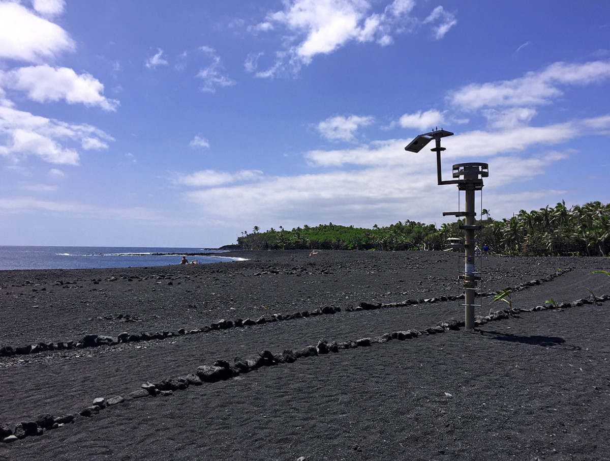 Pohoiki Bay AFTER the eruption - buried deep under thousands of tons of lava rocks and sands!  The sands also completely covered the pier.