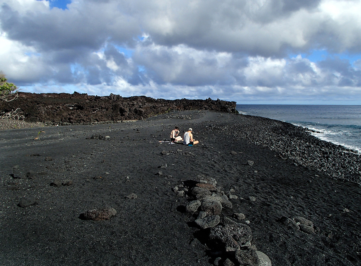 Looking north from the new beach toward where the lava flow solidified and formed a massive wall.  Behind it is an endless lava field!