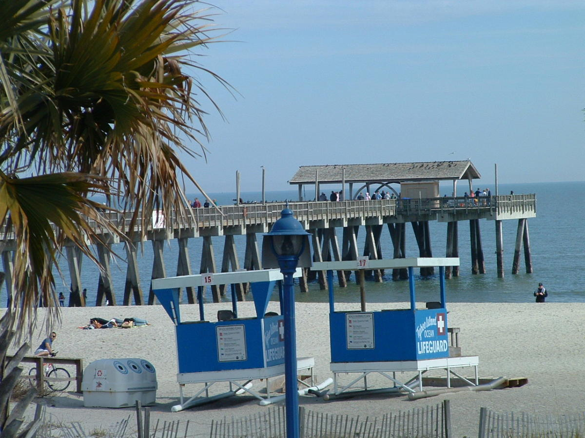 Tybee Island Fishing pier which juts out from beyond the gazebo entrance.