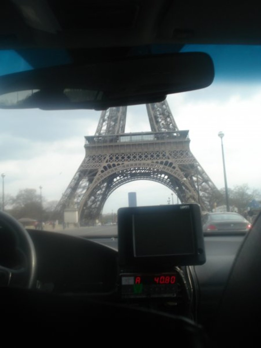Driving past the Eiffel tower on the way to the hostel from the airport.  To get from the airport to your hostel cheaply, use the metro which will cost you just a couple of Euros. A taxi will cost you over 50 Euros!