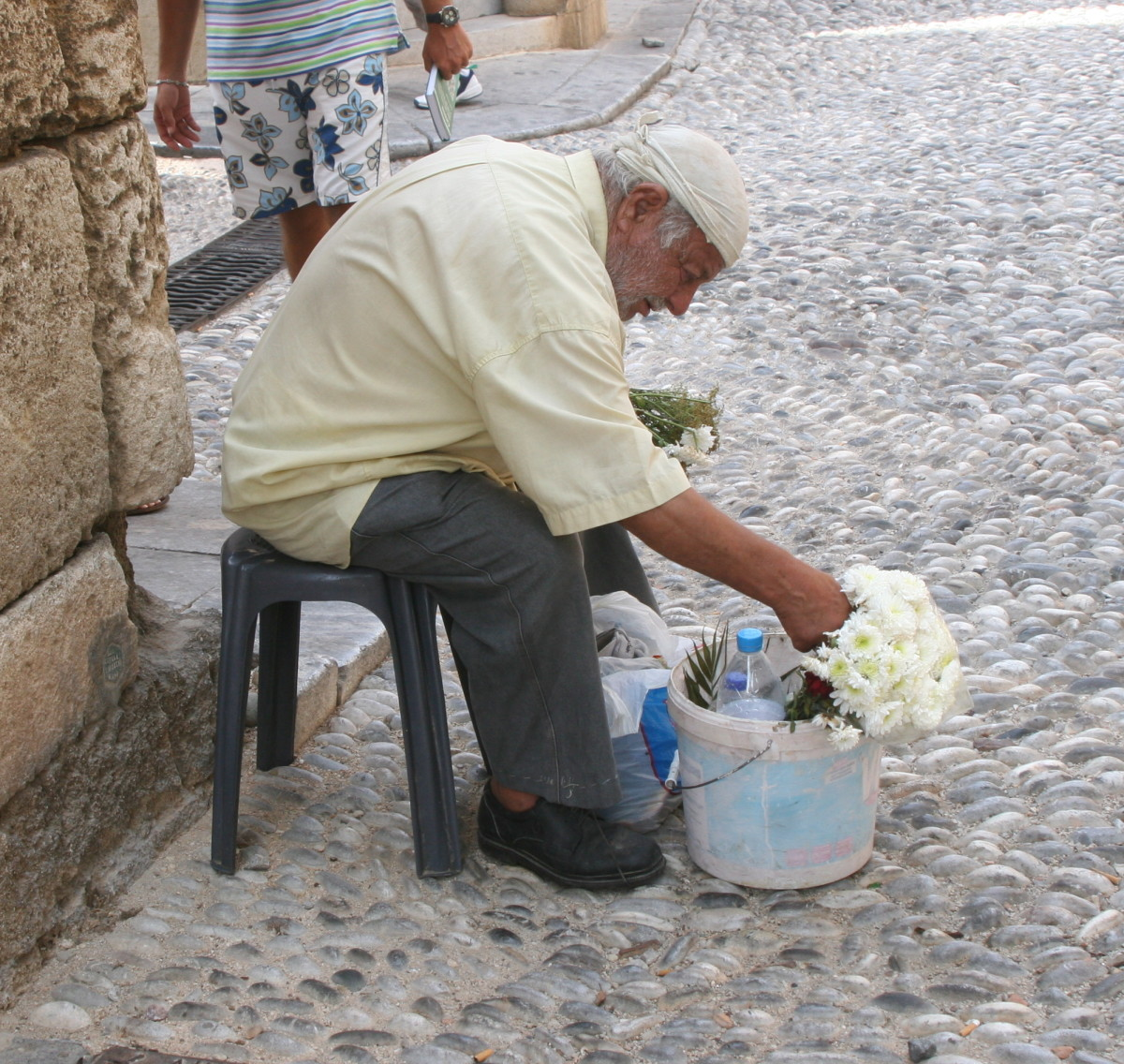 Man selling flowers in Rhodes, Greece
