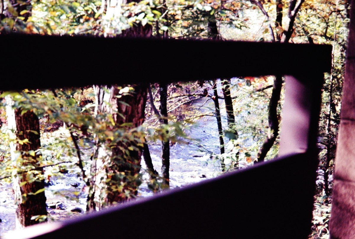 View looking through the railing of our balcony at the Little Pigeon River in Gatlinburg.