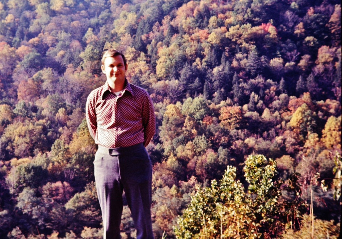 My hubby with the Smoky Mountain autumn leaves as a backdrop.