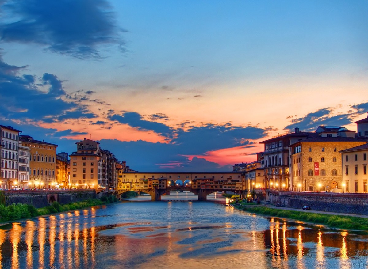 Florence, Ponte Vecchio and Arno river at sunset.
