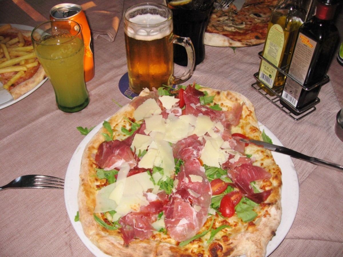 Italian Pizzerias offer a rich manu with several pages of topping choices. One pizza is served for each person - the crust is much thinner and lighter than American pizza.