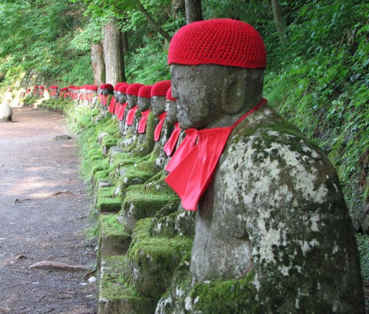 Jizo statues, watching over Kanmangafuchi abyss.
