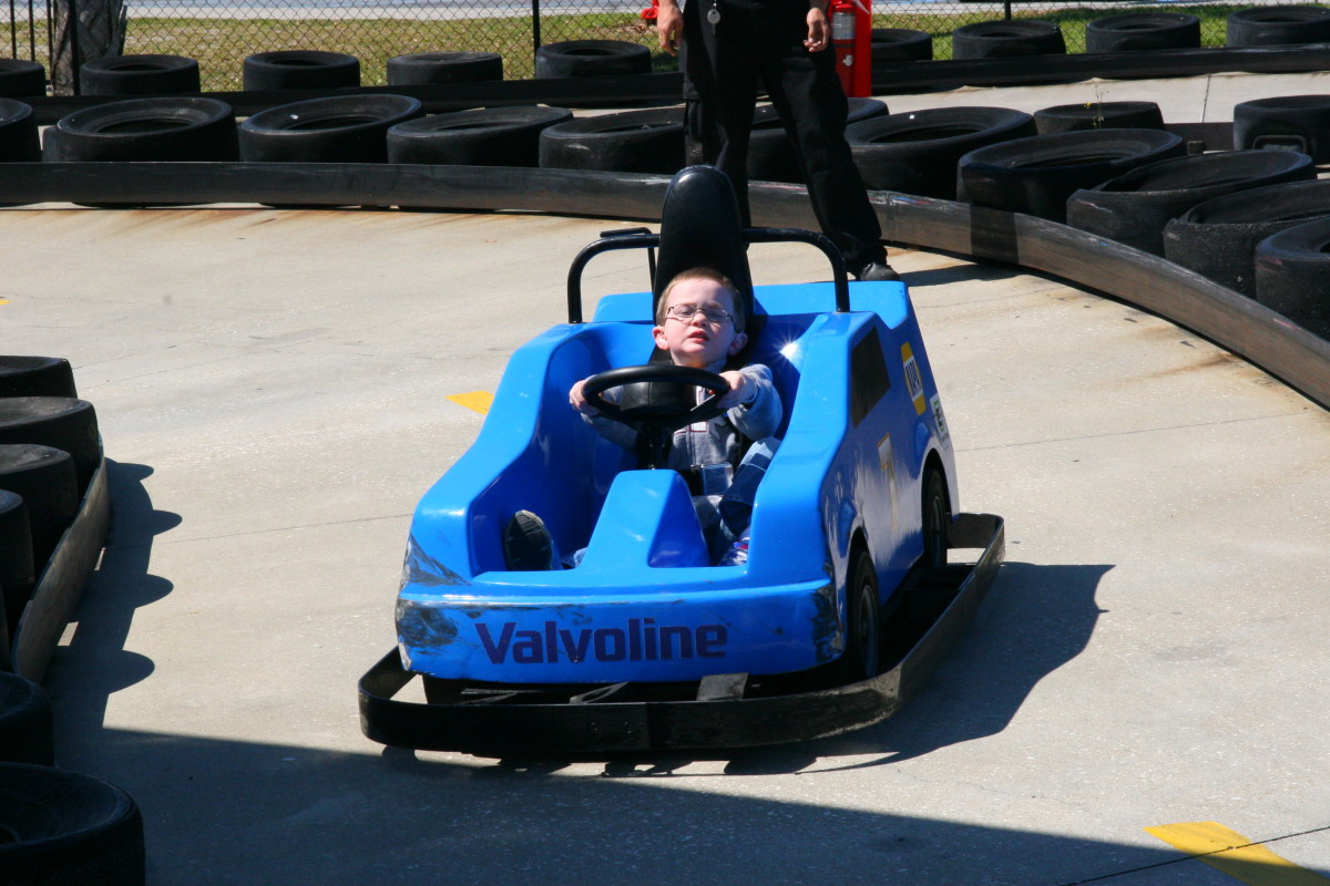 My four year old son barely made the height limit, and had difficulty reaching the gas pedal. He found that he enjoyed the other rides a bit more, as the cars took a lot of effort for him to drive.
