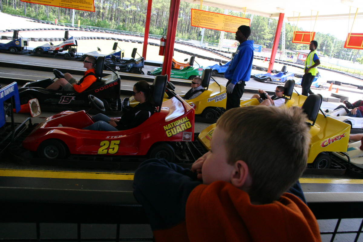 Our six year old son waits in line for the Family 500. He was not tall enough to drive, but could ride as a passenger.