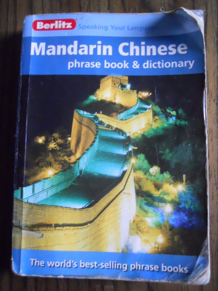 A phrase book will get you far. This book was given to me by a friend of mine who didn't need it anymore. You can use a phrase book as an aide to learning Chinese. It can also be used to communicate with others by pointing to the Chinese characters.