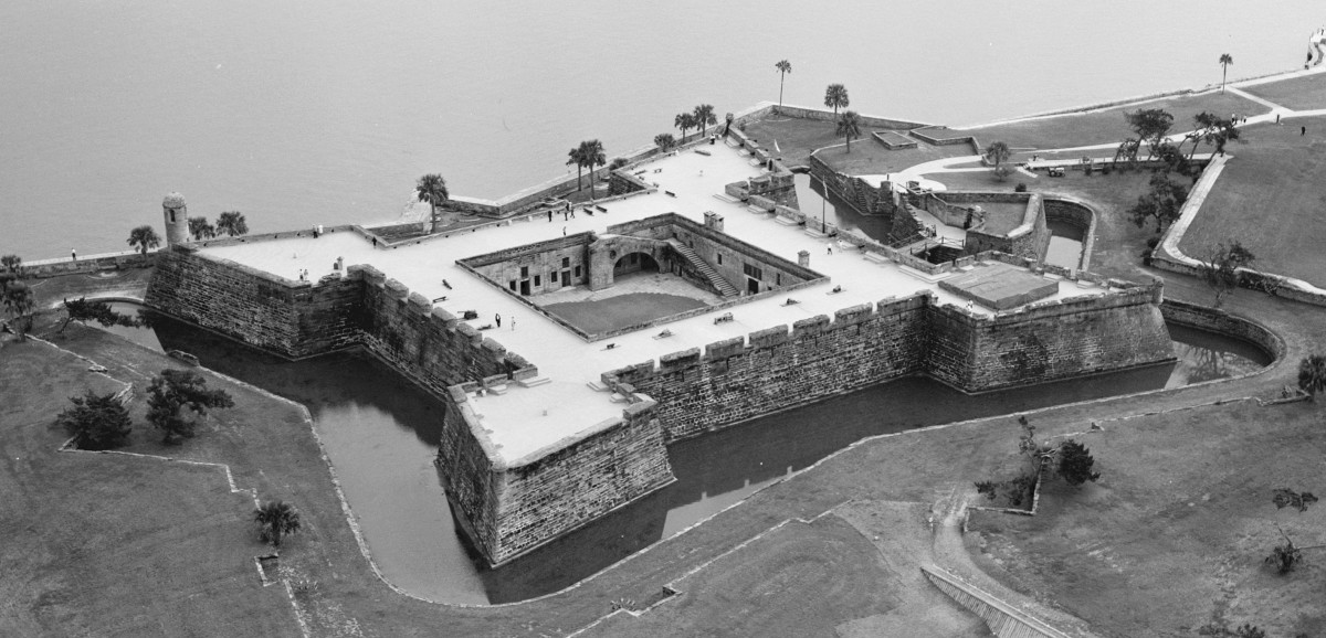 "An aerial view of the fort.  It is constructed from  a stone called coquina, which is Spanish for ""small shells"", essentially ancient shells that have come together to form a kind of stone similar to limestone.  The fort took 23 years to build."