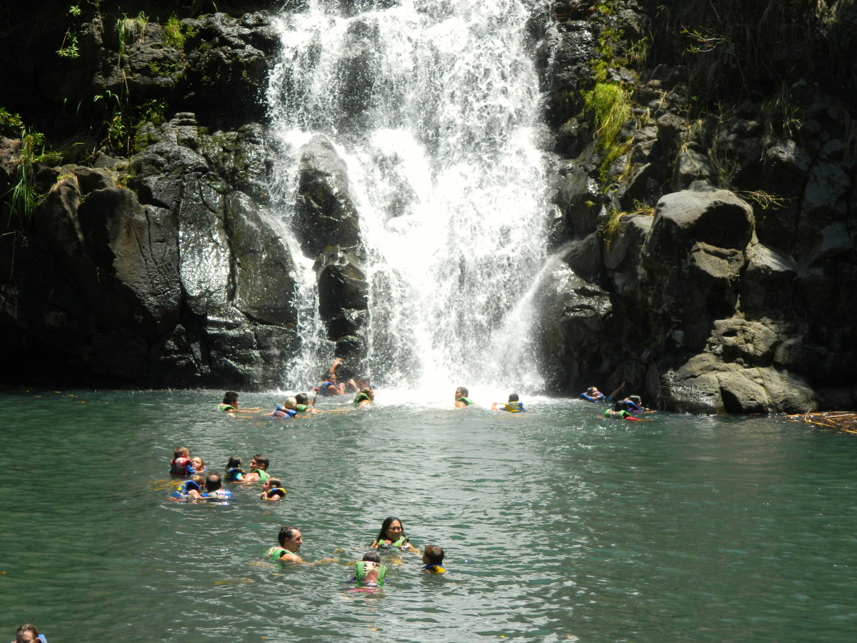 Waimea Falls. Visitors are welcome to take a dip at the foot of the waterfall while in Waimea Valley.