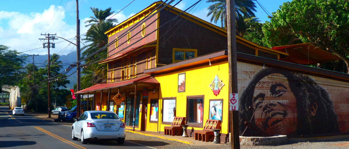 Surf shop with Bob Marley mural. All of the old buildings in Hale'iwa have been spruced up and newly repainted.