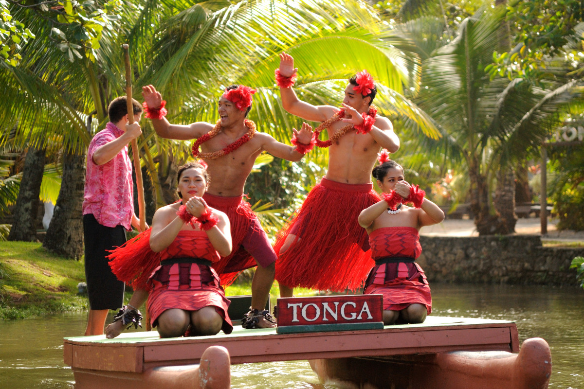 The Parade of Canoes takes place every afternoon at the Polynesian Cultural Center.  Tongan dancers perform on a floating canoe in this photo.