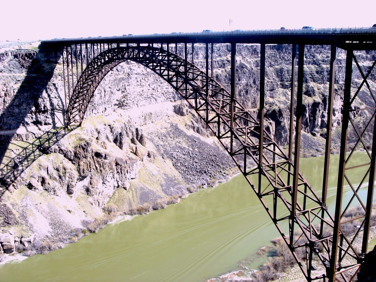 The thin line of dirt at the lower bridge support is the original depth of the canyon before the Bonneville flood.