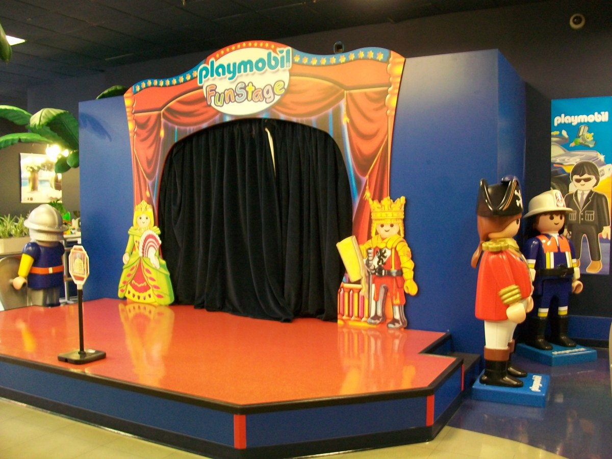 The stage is used for activities and games.