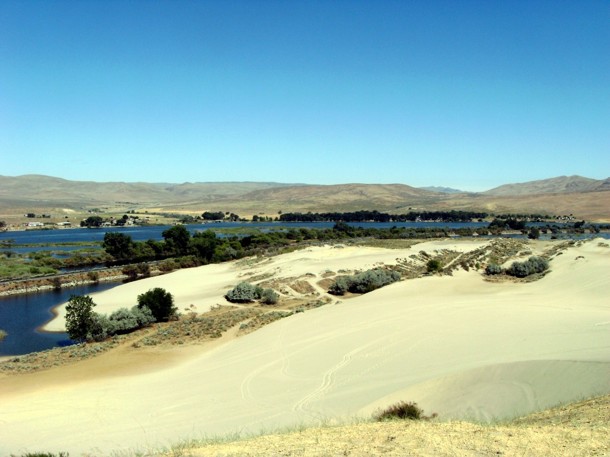 The sand has been shaped by wind and weather for thousands of years now.  The river curve is visible in the background.