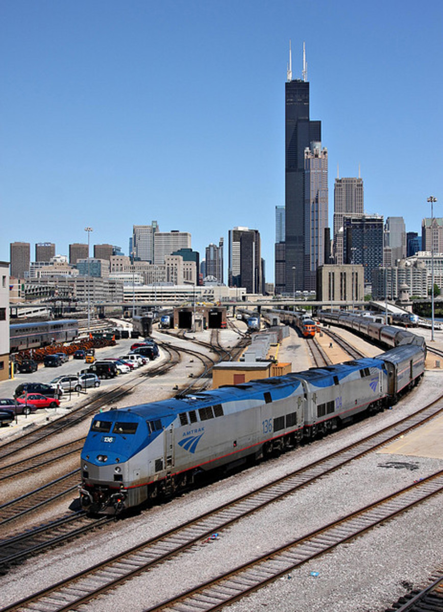 In a quintessential Chicago shot, Amtrak #49, the Lake Shore Limited, backs in to Union Station. Note the 261 cars on the tail of Amtrak #7 just above the second loco in the consist.