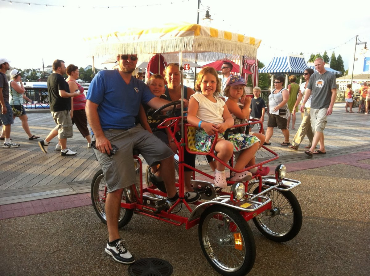 Renting a bicycle contraption at the Boardwalk across the lake.