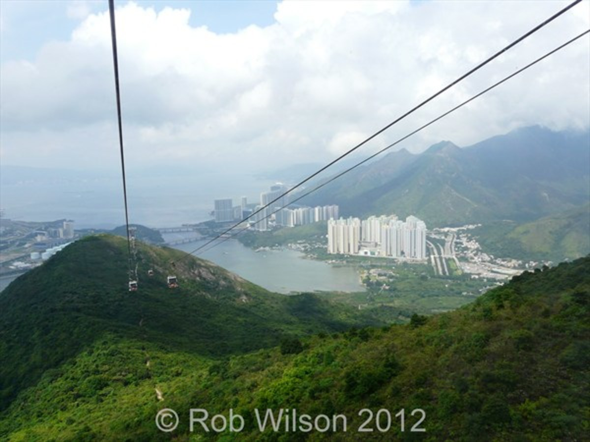 Ngong Ping 360 Cable Car looking down towards Tung Chung Hong Kong and Tung Chung bay.