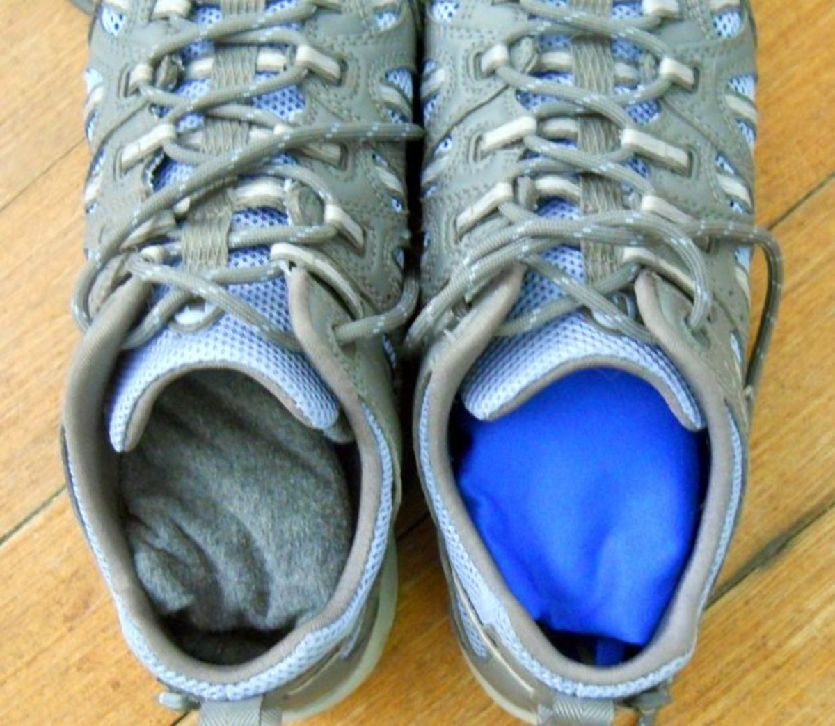 Running outfit folded neatly inside running shoes