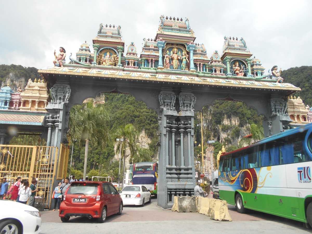 Cars and tourist buses entering the carpark to the Batu Caves.