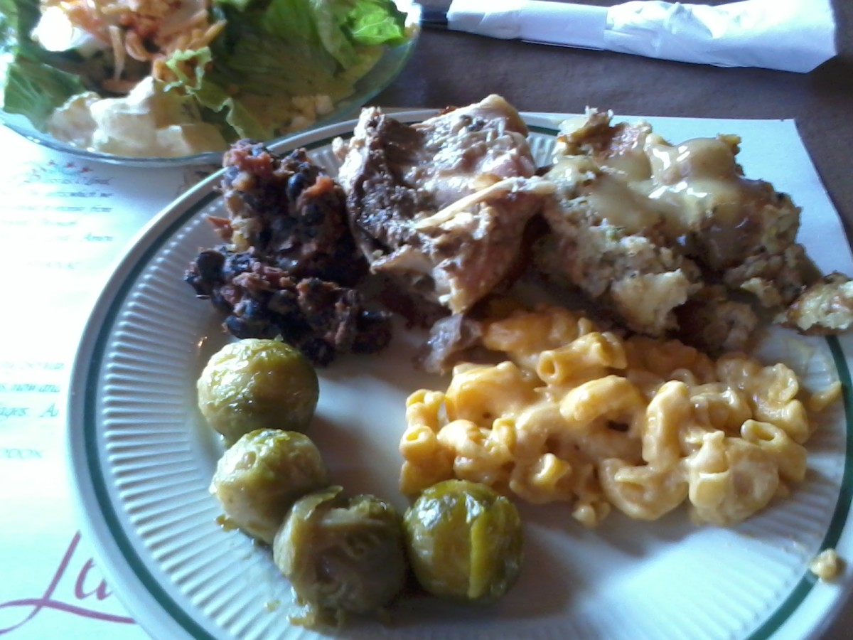 A dainty and delicious salad; Brussels sprouts, real mac and cheese, stuffing with chicken gravy, roasted chicken, and black bean and sausage stew