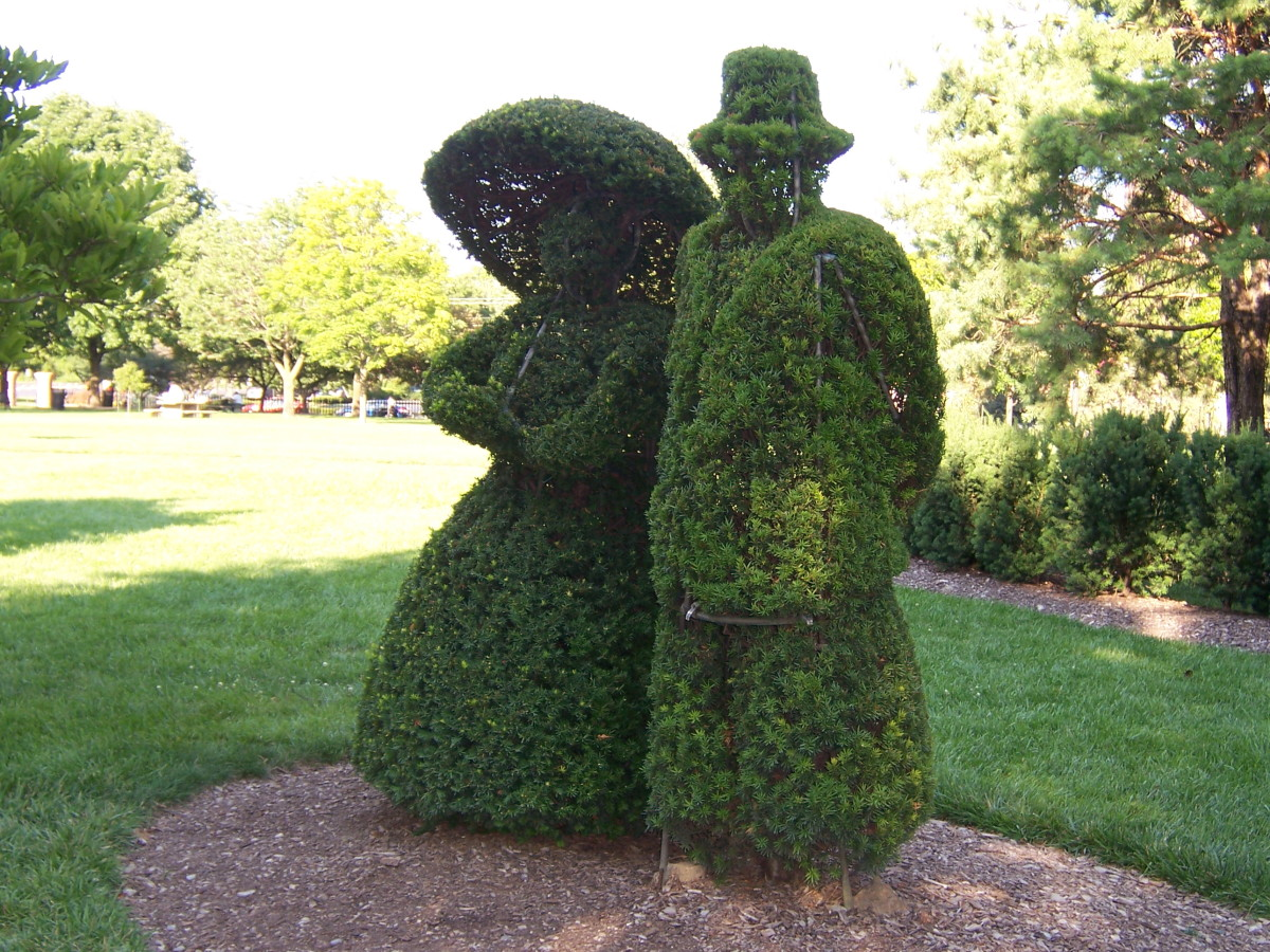 These two topiaries are a part of the whole that recreate a painting of a landscape at this park.